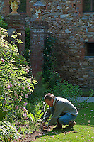 Paul Gervais the owner of the Villa Massei photographed working hard on a flowerbed in the extensive grounds