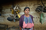 Audelina Vasquez Lopez, a Maya Mam woman, in front of her home in Tuixcajchis, a small village in Comitancillo, Guatemala.