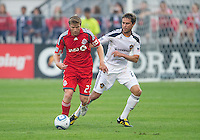 26 June 2010: Toronto FC midfielder Jacob Petersen #23 and Los Angeles Galaxy defender Todd Dunivant #2 battle for a ball during a game between the Los Angeles Galaxy and the Toronto FC at BMO Field in Toronto..Final score was 0-0...