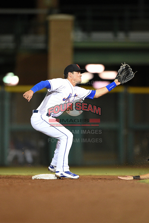 Scottsdale Scorpions infielder Matt Reynolds (3) stretches for a throw during an Arizona Fall League game against the Surprise Saguaros on October 15, 2014 at Scottsdale Stadium in Scottsdale, Arizona.  Surprise defeated Scottsdale 13-11.  (Mike Janes/Four Seam Images)