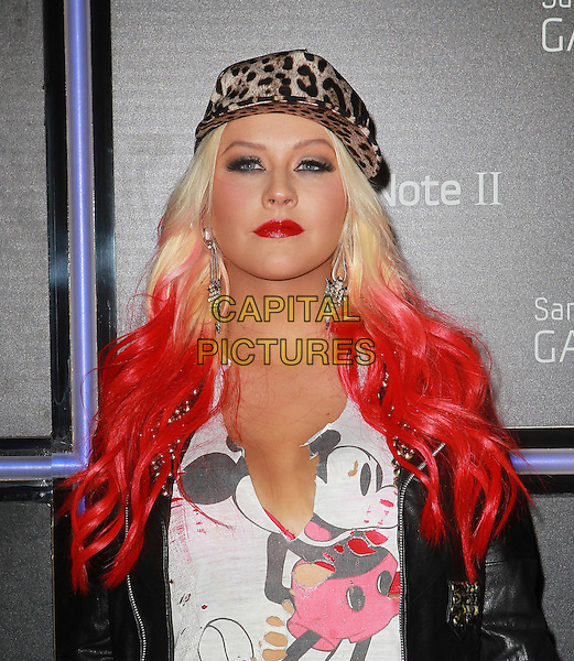 Christina Aguilera.Samsung Mobile Launch Party For The New Samsung Galaxy Note II Held At Private Residence, Beverly Hills, California, USA, 25th October 2012..half length red dyed hair make-up lipstick Mickey mouse ripped top t-shirt black leather jacket leopard print cap hat  studded .CAP/ADM/KB.©Kevan Brooks/AdMedia/Capital Pictures.
