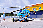 2 August 2009: A Bell Jet Ranger helicopter is prepared for flight by Blue Skies Charter Service prior to a flight above the Caribbean town of Willemstad, on the island of Curacao, in the Netherlands Antilles. Curaçao is known for tourism, scuba diving, and technologically advanced business districts. Mandatory Photo Credit: Ed Wolfstein Photo