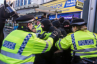 EDL protest and counter demonstration Slough, England 1-2-14 The far right English Defence League holds a national protest in Slough. Between 150-200 EDL supporters marched under heavy Police protection. A much larger counter demostration called by Unite Against Fascism, Slough Trades Council and ANTIFA  was attended by a large contingent of local youth and blocked the route of the EDL march and scuffled with Police.