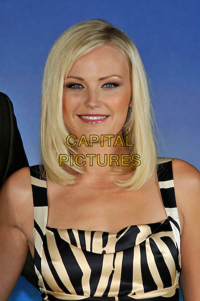 "MALIN AKERMAN.Photocall for the film ""Couples Retreat"", Claridges, London, England..October 15th, 2009.headshot portrait ackerman white cream black zebra print striped stripes animal.CAP/PL.©Phil Loftus/Capital Pictures."