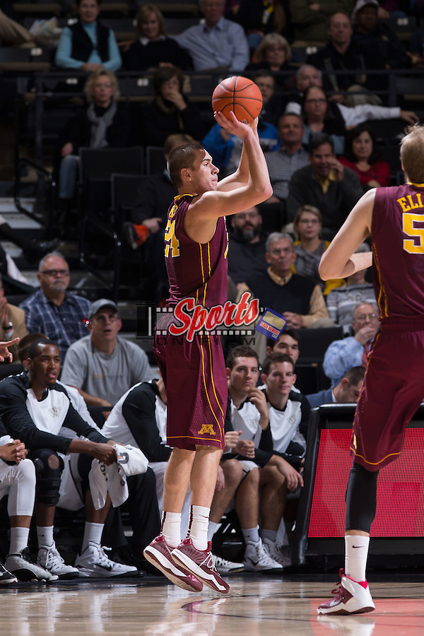 Joey King (24) of the Minnesota Golden Gophers attempts a jump shot during first half action against the Wake Forest Demon Deacons at the LJVM Coliseum on December 2, 2014 in Winston-Salem, North Carolina.  The Golden Gophers defeated the Demon Deacons 84-69. (Brian Westerholt/Sports On Film)