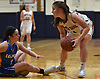 Erin McElwain #21 of South Side, right, looks to pass after gaining possession of a loose ball during a non-league girls basketball game against East Meadow at South Side High School in Rockville Centre on Tuesday, Nov. 27, 2018. South Side won by a score of 68-29.