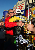 Nov. 11, 2012; Pomona, CA, USA: NHRA team owner Don Schumacher (left) hugs funny car driver Jack Beckman after clinching the 2012 championship during the Auto Club Finals at at Auto Club Raceway at Pomona. Mandatory Credit: Mark J. Rebilas-