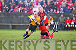 Listowel Emmets Brian Scanlon(15) feels the pressure from Kieran Deenihan(9) and Jason Wrenn(7) of Tarbert in the North Kerry Senior Football Final held last Sunday in Bob Stack Park, Ballybunion.