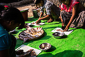 Villagers cut and clean the fish as part of the post harvest activity in the fisheries in Damin Naung village in Pyapon district of Myanmar.