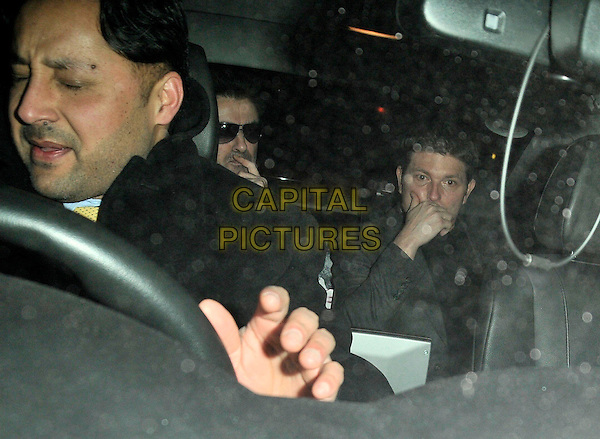 GEORGE MICHAEL & KENNY GOSS .Spotted out and about in Burton Street, London, England, February 7th 2009..portrait headshot in car shot  hand over mouth sunglasses .CAP/CAN.©Can Nguyen/Capital Pictures