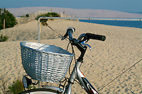 Bicycle with a basket is parked at the beach, Arcachon Bay, Aquitaine, France.