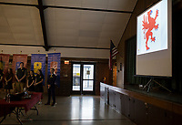 NWA Democrat-Gazette/CHARLIE KAIJO An emblem of the Griffin, Ozark Catholic's new mascot, is displayed on a projector during an open house, Sunday, March 4, 2018 at Ozark Catholic Academy in Tontitown.<br /><br />Ozark Catholic Academy, which is gearing up to open this fall, celebrated a milestone as they announced their mascot.