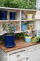 63821-20406 Potting bench with containers and flowers in spring, Marion Co. IL