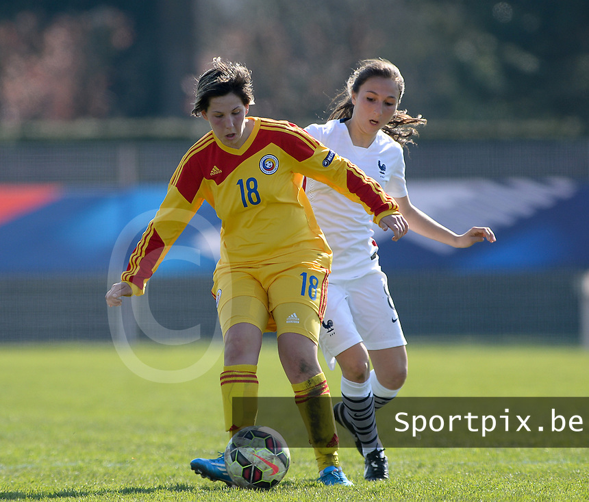 20150406 - OZOIR , FRANCE  : Romanian Demi Rus (left) pictured in action with French Laura Condon (right) during the soccer match between Women Under 19 teams of France and Romania , on the second matchday in group 3 of the UEFA Elite Round Women Under 19 at Stade des 3 Sapins , Ozoir La Ferriere , France . Monday 6th April 2015 . PHOTO DAVID CATRY