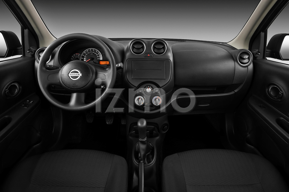 Straight dashboard view of a 2011 Nissan Micra Visia 5 Door Micro Car  .