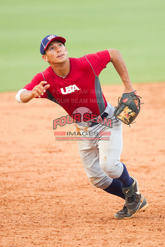 Third baseman Phillip Evans #28 of Team Red on defense against Team Blue during the USA Baseball 18U National Team Trials at the USA Baseball National Training Center on June 30, 2010, in Cary, North Carolina.  Photo by Brian Westerholt / Four Seam Images