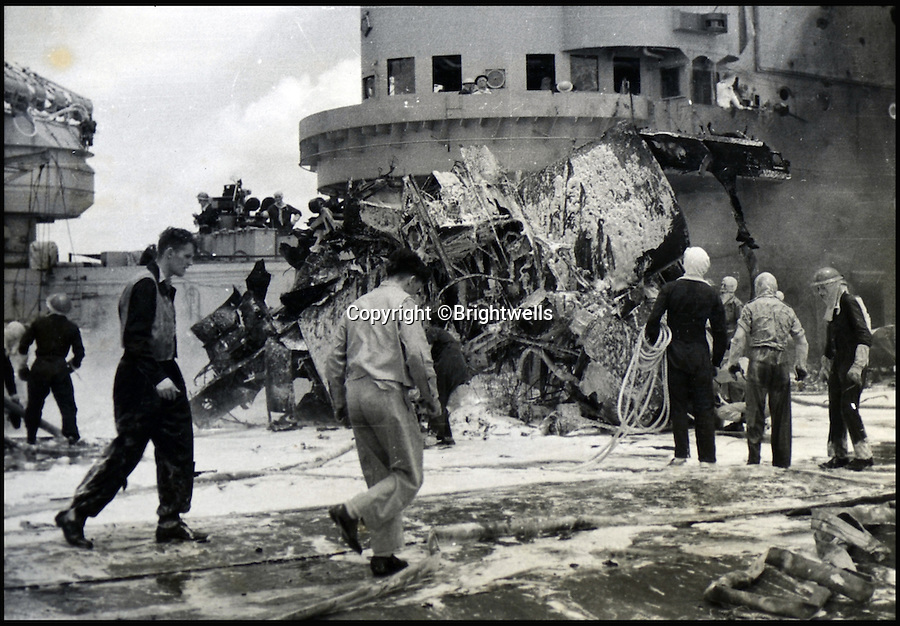 BNPS.co.uk (01202 558833)<br /> Pic: Brightwells/BNPS<br /> <br /> The aftermath of a Kamikaze attack on the H.M.S Formidable.<br /> <br /> A remarkable photo album showing the brutal aftermath of Kamikaze attacks and crash landings on Allied aircraft carriers in the Second World War has been uncovered after 70 years.<br /> <br /> The 112 original photographs of the Royal Navy Pacific Fleet in 1945 include a host of images showing the flaming wreckage of Japanese planes that were deliberately flown into the superstructure of ships by suicidal pilots.<br /> <br /> There are also harrowing photos of US fighter planes bursting into flames on landing on the flight deck as well as one crashing into the sea.<br /> <br /> The album is being sold by Brightwells Auctioneers in Herefordshire.