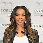 NEW ORLEANS, LA - JULY 5: Recording artist Michelle Williams attends the 2014 Essence Music Festival at the Mercedes-Benz Superdome on July 5, 2014 in New Orleans, Louisiana. Photo Credit: Morris Melvin / Retna Ltd.