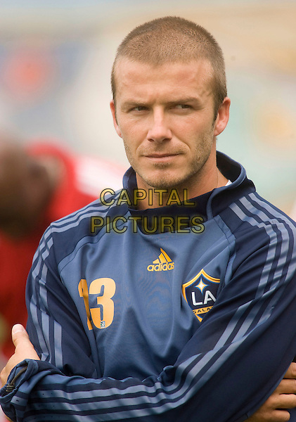 DAVID BECKHAM .New York Red Bulls Soccer Clinic to benefit the Harlem Youth Soccer's team, the FC Harlem Lions, at the Jacob Schiff Field in Upper Manhattan, New York, NY, USA, August 17, 2007..half length blue sports top football kit arms crossed folded.CAP/AND/LNC.©LNC/Capital Pictures.
