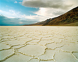 USA, California, badwater salt flats with mountains in the background, Death Valley National Park