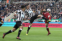 Liverpool's Mohamed Salah vies for possession with Newcastle United's Ciaran Clark<br /> <br /> Photographer Rich Linley/CameraSport<br /> <br /> The Premier League -  Newcastle United v Liverpool - Sunday 1st October 2017 - St James' Park - Newcastle<br /> <br /> World Copyright &copy; 2017 CameraSport. All rights reserved. 43 Linden Ave. Countesthorpe. Leicester. England. LE8 5PG - Tel: +44 (0) 116 277 4147 - admin@camerasport.com - www.camerasport.com