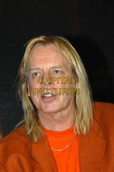RICK WAKEMAN of YES.Proressive rock band Yes meet their of fans and sign pre-release copies of their new dvd Yes Acoustic at HMV Oxford Circus, London, .17th June 2004..portrait headshot long hair red orange jacket t shirt .www.capitalpictures.com.sales@capitalpictures.com.©Capital Pictures