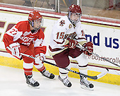 Tara Watchorn (BU - 27), Emily Field (BC - 15) - The visiting Boston University Terriers defeated the Boston College Eagles 4-1 on Wednesday, November 2, 2011, at Kelley Rink in Conte Forum in Chestnut Hill, Massachusetts.