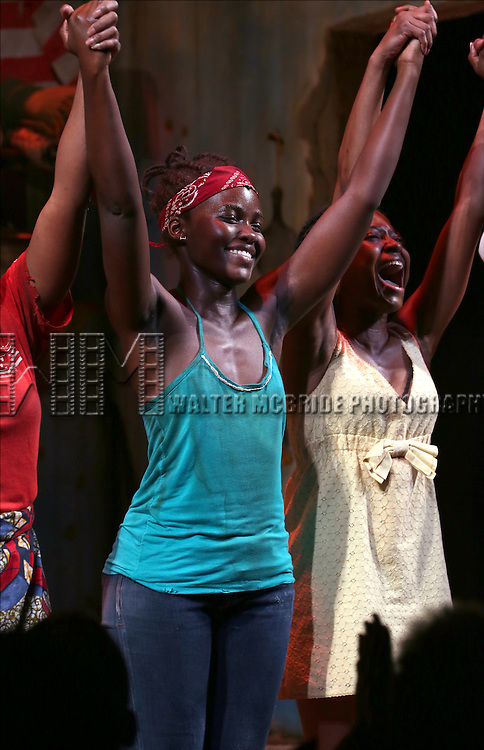 Lupita Nyong'o and Pascale Armand onstage during the 'Eclipsed' broadway opening night curtain call at The Golden Theatre on March 6, 2016 in New York City.
