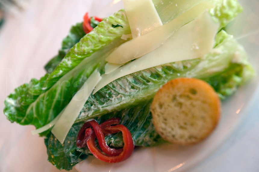 Romaine Salad with shaved Parmesan cheese.