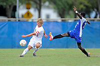 2 October 2011:  FIU defender Anthony Hobbs (16) passes the ball despite the efforts of Kentucky forward Cameron Wilder (12) in the second half as the FIU Golden Panthers defeated the University of Kentucky Wildcats, 1-0 in overtime, at University Park Stadium in Miami, Florida.