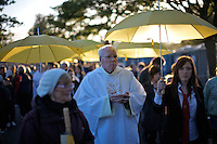 Around 70,000 people celebrate open-air mass at Bellahouston park, Glasgow for the visiting Pope Benedicte XVI on the first state visit to Scotland...Communion is served by priests.
