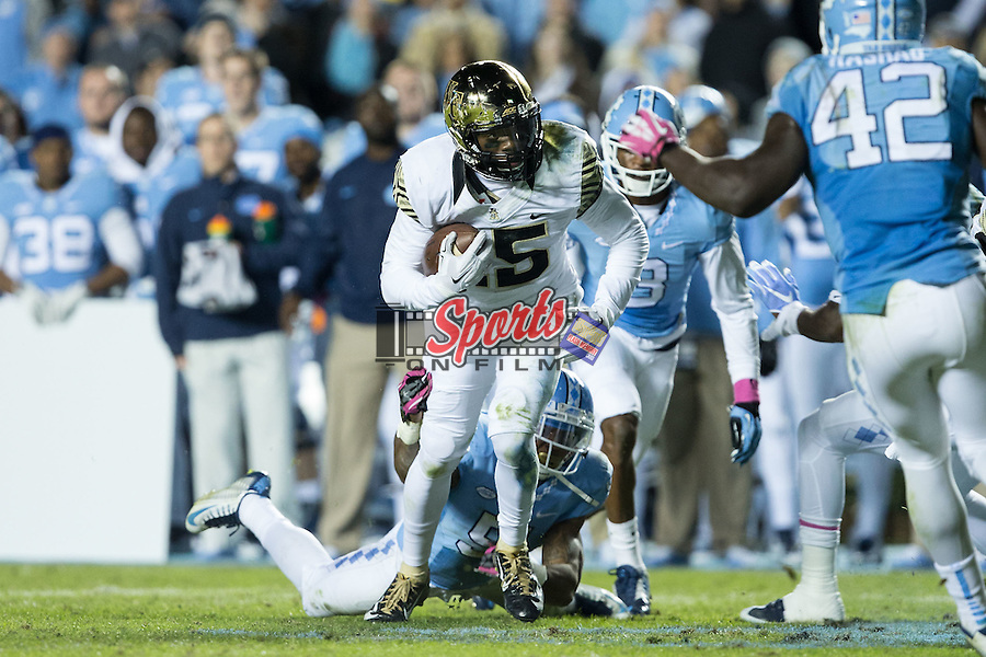 Cortez Lewis (15) of the Wake Forest Demon Deacons tries for extra yards after catching a pass during second half action against the North Carolina Tar Heels at Keenan Stadium on October 17, 2015 in Chapel Hill, North Carolina.  The Tar Heels defeated the Demon Deacons 50-14.   (Brian Westerholt/Sports On Film)