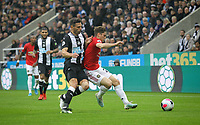 Daniel James of Man Utd & Ciaran Clark of Newcastle United during the Premier League match between Newcastle United and Manchester United at St. James's Park, Newcastle, England on 6 October 2019. Photo by J GILL / PRiME Media Images.