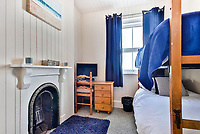 BNPS.co.uk (01202 558833)<br /> Pic: March&Petit/BNPS<br /> <br /> Pictured: Bedroom<br /> <br /> A charming clifftop cottage which offers breathtaking views of the English channel has emerged on the market for £450,000.<br /> <br /> Mildmay Cottage, in the fishing village of North Hallsands, Devon, backs on to the scenic South West Coastal Path.<br /> <br /> The front door of the three bedroom early 20th century former fisherman's property is just 4ft from the cliff edge.<br /> <br /> It looks out over Start Bay with its historic early 19th century lighthouse and the spectacular Dartmouth headland.<br /> <br /> The home is for sale with estate agent Marchard Petit who say the area is celebrated for its numerous unspoilt coves and beaches.