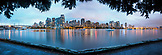 CANADA, Vancouver, British Columbia, looking across False Creek towards Yaletown and Davie Village at night, view from Charleson Park