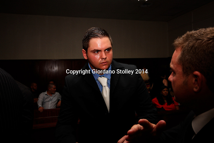 DURBAN - 10 March 2014 -  Four men -- Andries van der Merwe (centre) talks to his advocate Willie Lombard in the Durban Regional Court. Van der Merwe, along with four others, faces charges related to the fatal beating of former Royal Marine Brett Williams at Kings Park Stadium following a Super Rugby XV match in March 2013. Picture: Allied Picture Press/APP