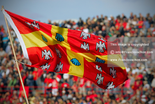 Universite Laval university flag flies over the crowd at stade du PEPS stadium during a Rouge et Or football game in Quebec City September 23, 2007.