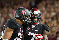 STANFORD, CA - October 5, 2013:  Stanford Cardinal players Tyler Gaffney (25) and Ty Montgomery (7) celebrate Montgomery's touchdown during the Stanford Cardinal vs the Washington Huskies at Stanford Stadium in Stanford, CA. Final score Stanford Cardinal 31, Washington Huskies  28.