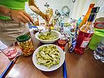 Nevena prepares dinner at the apartment in Mansummano, Tuscany, Italy
