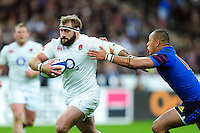 Joe Marler of England looks to get past Gael Fickou of France. RBS Six Nations match between France and England on March 19, 2016 at the Stade de France in Paris, France. Photo by: Patrick Khachfe / Onside Images
