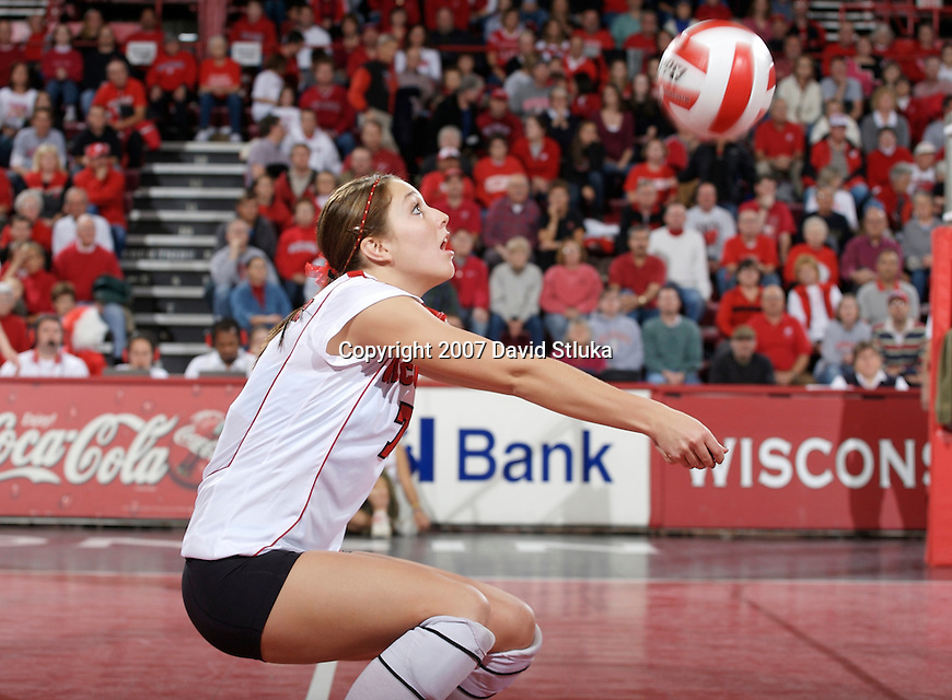 MADISON, WI - NOVEMBER 9: Brittney Dolgner #7 of the Wisconsin Badgers volleyball team bumps the ball against the Michigan Wolverines at the Field House on November 9, 2007 in Madison, Wisconsin. The Badgers beat the Wolverines 3-2. (Photo by David Stluka)