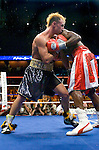 Uncasville, CT:  (l-r) Paulie Malignaggi  and Lovemore N'Dou clinch in the ring during their IBF Junior Welterweight Championship fight at the Mohegan Sun Casino, June 16th, 2007. Malignaggi won the belt from N'Dou by unanimous decision.. Photo by Thierry Gourjon.