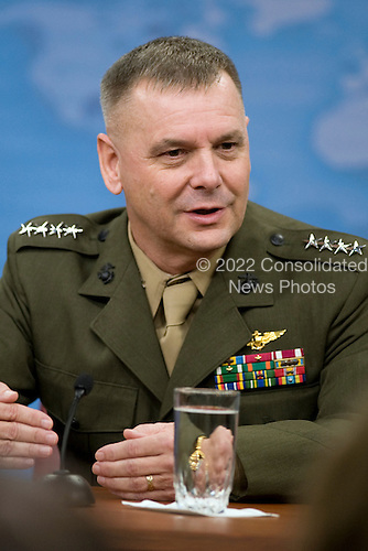 Vice Chairman of the Joint Chiefs of Staff General James E. Cartwright, United States Marine Corps, speaks with members of the Pentagon press corps during a press conference with U.S. Secretary of Defense Robert M. Gates (not pictured) in the Pentagon on August 13, 2009.  Cartwright is a target of a Justice Department investigation into a leak of information about a covert U.S.-Israeli cyberattack on Iran&rsquo;s nuclear program.<br /> Mandatory Credit: Cherie Cullen / DoD via CNP