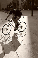 Shadow of a bicycle messenger on King Street West in downtown Toronto....    photo by Pierre Roussel - Images Distribution