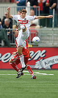 16 May 09: Chicago Fire defender Brandon Prideaux #6 kicks a ball away from Toronto FC forward Pablo Vitti #8 during action at BMO Field in a game between the Chicago Fire and Toronto FC..Chicago Fire won 2-0..