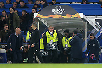 Chelsea Manager, Maurizio Sarri walks down the tunnel at the final whistle as Malmo FF Manager, Uwe Rosler looks across expecting a handshake during Chelsea vs Malmo FF, UEFA Europa League Football at Stamford Bridge on 21st February 2019
