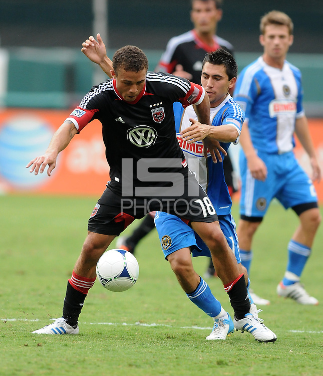 D.C. United midfielder Nick DeLeon (18) shields the ball from Philadelphia Union defender Gabriel Farfan (15) D.C. United tied The Philadelphia Union 1-1 at RFK Stadium, Saturday August 19, 2012.