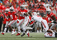 Ohio State Buckeyes running back Mike Weber (25) breaks away from Rutgers Scarlet Knights defensive back Saquan Hampton (9) on a run during the first quarter of the NCAA football game at Ohio Stadium in Columbus on Sept. 8, 2018. [Adam Cairns / Dispatch]