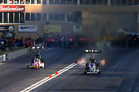 Jul. 20, 2013; Morrison, CO, USA: NHRA top fuel dragster driver Shawn Langdon (right) races alongside Doug Kalitta during qualifying for the Mile High Nationals at Bandimere Speedway. Mandatory Credit: Mark J. Rebilas-