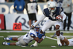 Nevada's Nigel Westbrooks (3) attempts to break a tackle from Air Force's Kalon Baker (28) during the first half of an NCAA football game in Reno, Nev., on Saturday, Sept. 28, 2013. (AP Photo/Cathleen Allison)